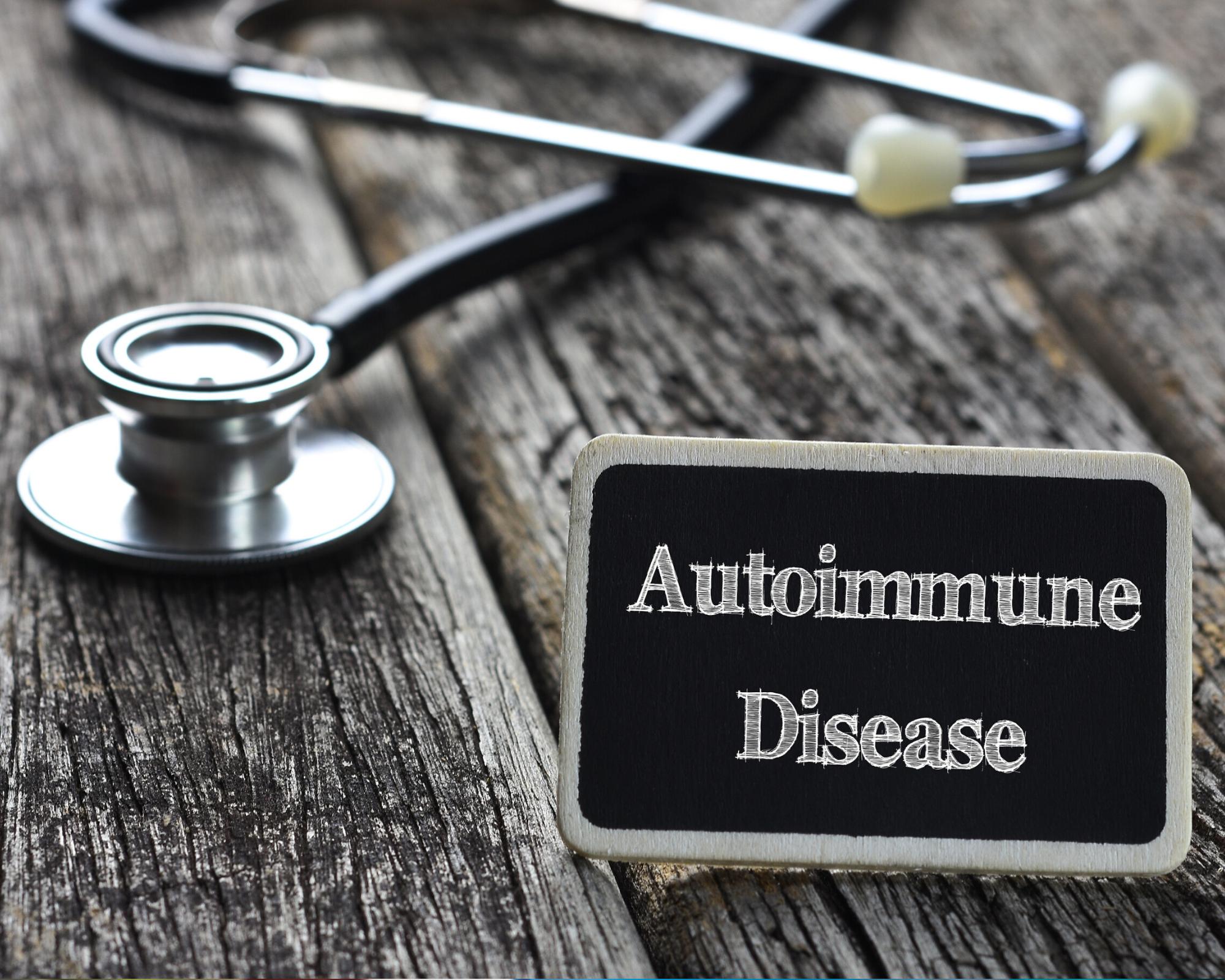 Medical Imagery of stethoscope next to sign saying autoimmune disease