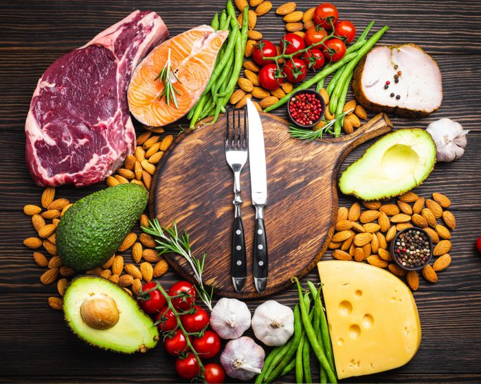 Collage of meat, vegetables & nuts suitable for a low carb, high protein paleo-based diet.