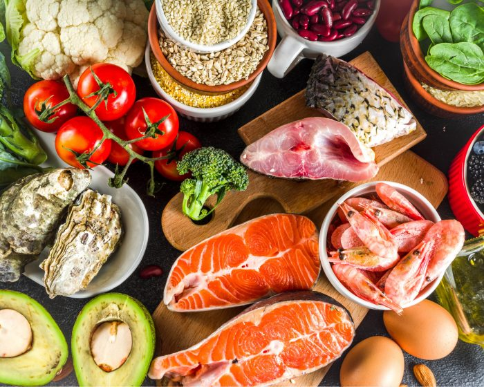 Collage of seafood, vegetables & fruits suitable for a pescatarian meal plan.